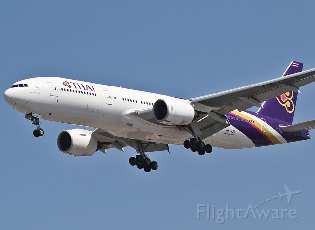 Boeing 777-200 (HS-TJS) - Landing at the LAX.
