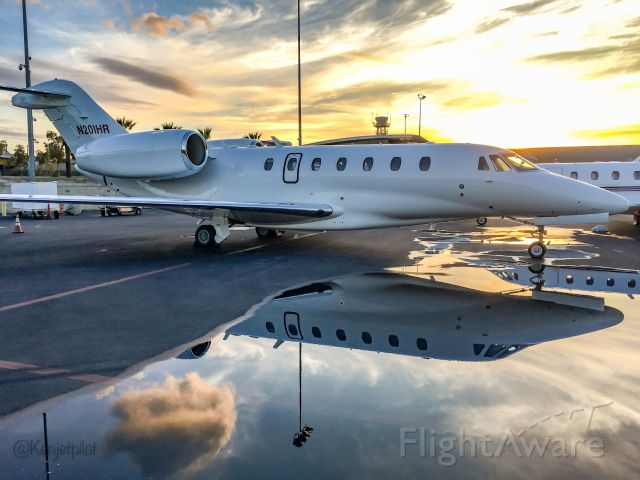 Cessna Citation X (N201HR) - It never rains at LAX - but when it pours, find a puddle and take your shot.
