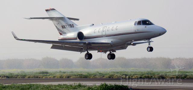 Cessna Citation Sovereign (N877QS) - NetJets Hawker landing at the Merced Regional Airport
