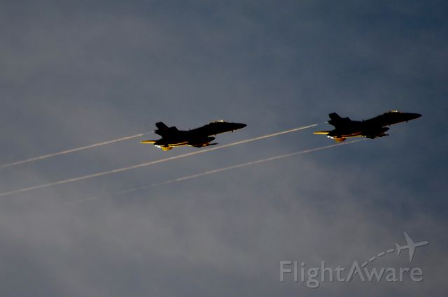 McDonnell Douglas FA-18 Hornet — - streamers  coming of the wings of these two growlers on approach to Anderson.