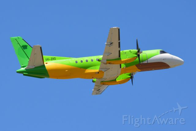 Saab 340 (VH-ZXS) - Getting airborne off runway 23 and heading off to another regional destination. Still in the livery of its former operator, Thailand's Happy Airlines. Thursday 6th March 2014.