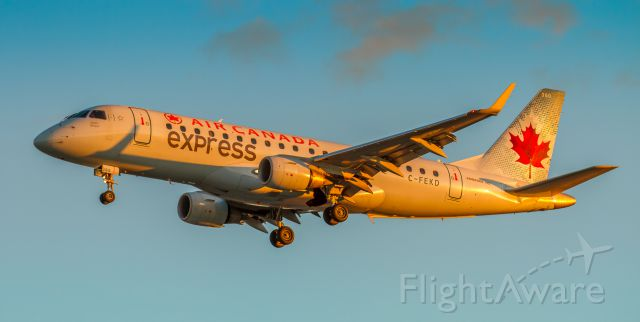 Embraer 170/175 (C-FEKD) - Sunset at YYZ as this Sky Regional Embraer approaches runway 05