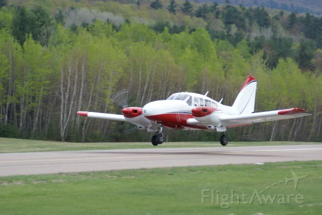 Piper Aztec (N52HF) - Departure from Middlebury VT after new paint job by J&M