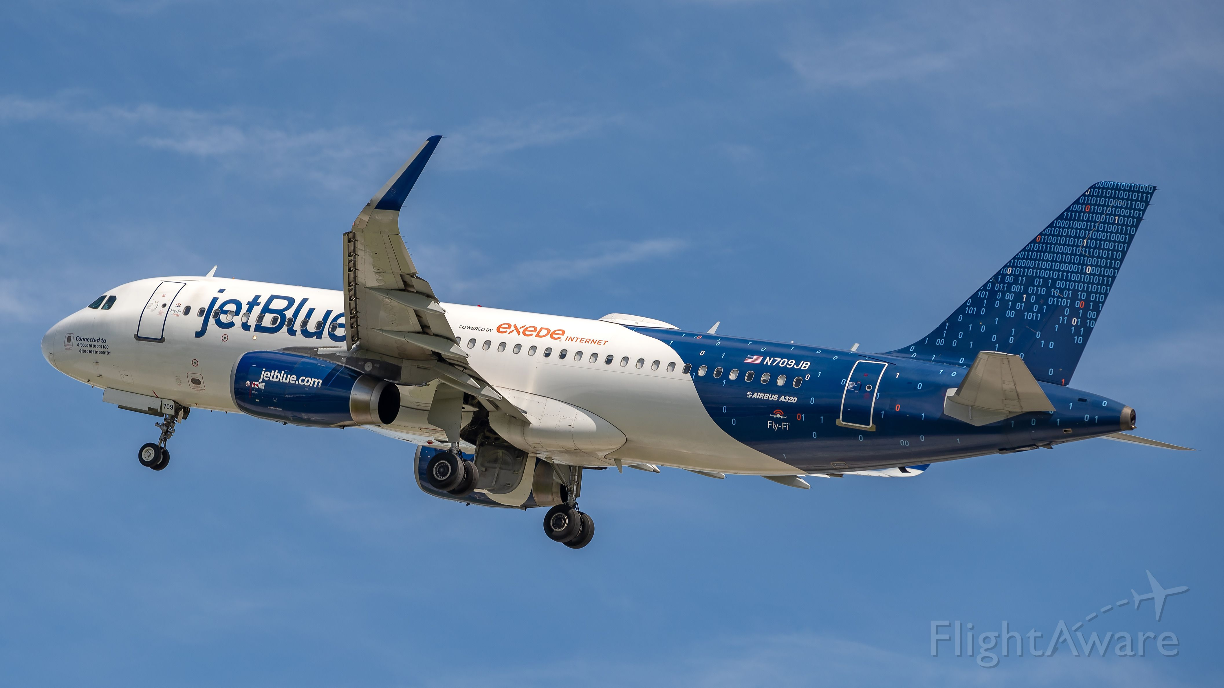 Airbus A320 (N709JB) - Jetblue A320 Binary livery taking off from runway 28L at KFLL