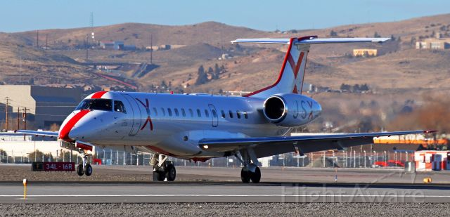 Embraer ERJ-135 (N254JX) - The pilots of JSX's N254JX are just about to put the nose gear in contact with the concrete as they land on Runway 16L.