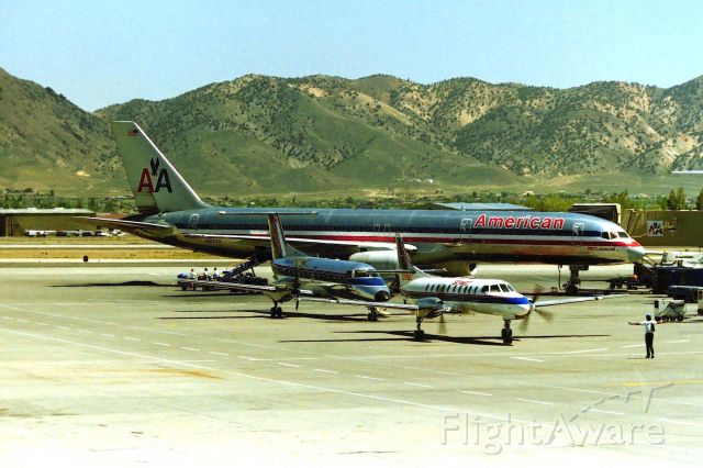 Boeing 757-200 (N612AA) - KRNO - American Airlines 757 on the ramp and sharing space with 2 twin commuters on a nice summer day in Reno. This 757-2 is long gone, scrapped in Roswell in 2014. cn: 24488 ln: 240. photo date apprx Aug 1999.