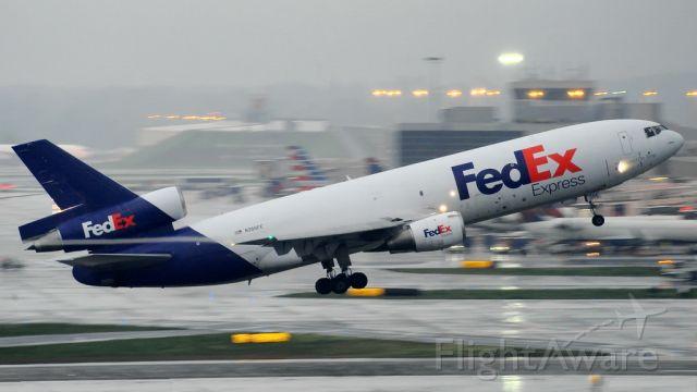 McDonnell Douglas DC-10 (N336FE) - Taking off in Atlanta on a rainy day