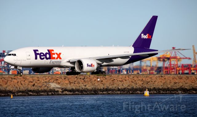 BOEING 777-200LR (N857FD) - Taxiing to the Freight Ramp