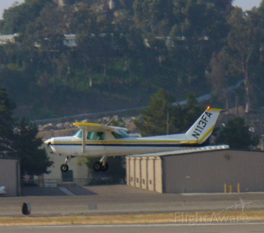 Cessna 152 (N113FA) - Another tired trainer landing 27L.