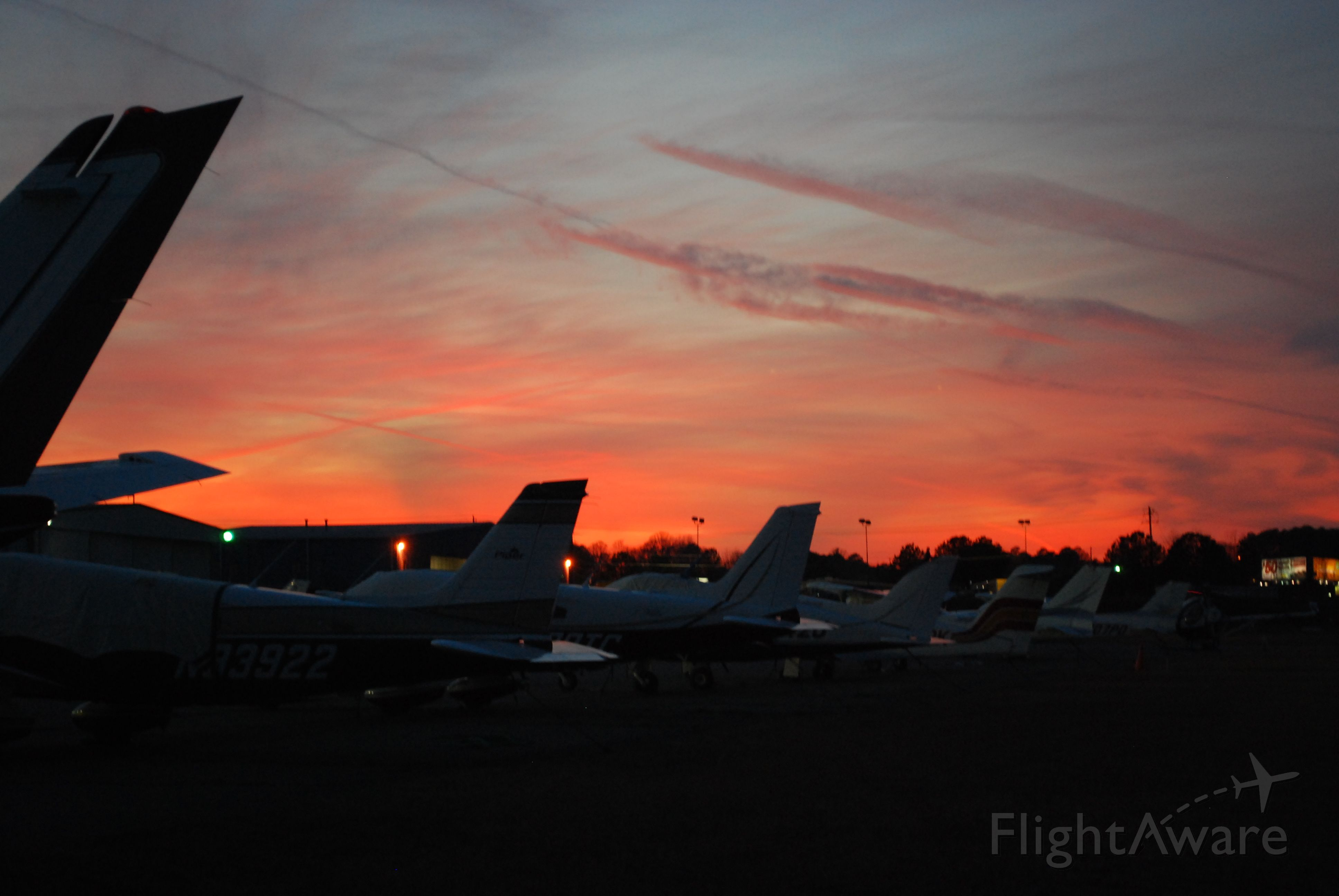 — — - Sunset at KRYY. con trails are fitting with the tails of aircraft in the picture