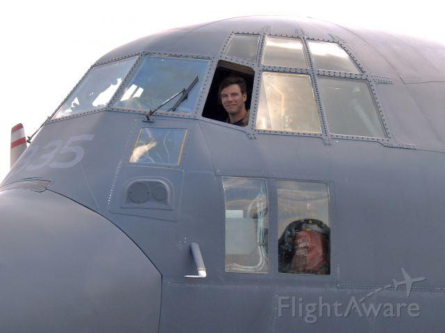 — — - Pilot seat of C-130 makes a man smile. Muskoka CYQA
