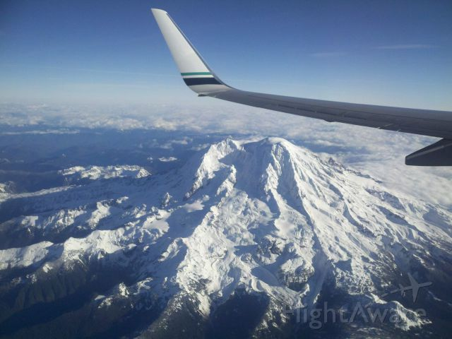 Boeing 737-800 — - Departure from Seattle, WA KSEA to Orlando, FL KMCO Flying over Mt. Rainier.