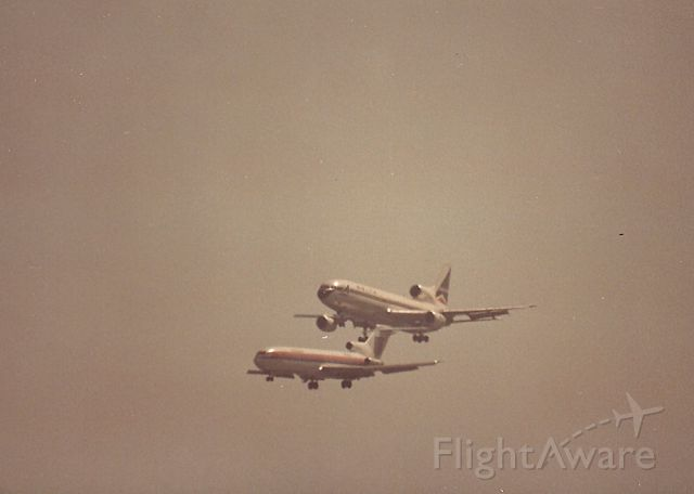 BOEING 727-200 — - KSFO - B727 and a Delta L-1011 on dual approach to runways 28 L/R in this late 1970s early 80s photo from Bayfront park- 35mm Minolta X7 1000mm Celestron Lens, long before the days of Digital lens and Ben Wang photos. Love that Flightaware watermark on the photo...................not!
