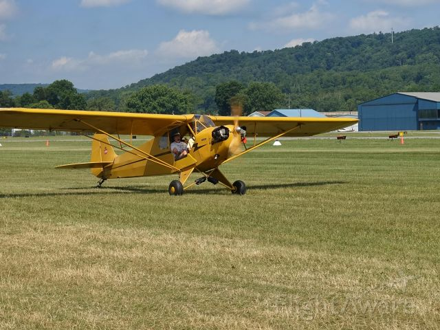 Piper NE Cub — - Taxiing to runway 27L at Lock Haven during the final day of Sentimental Journey 2016