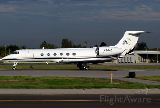 N70AG — - The San Diego Chargers G-V rolls for takeoff on Rwy 30 at Long Beach.