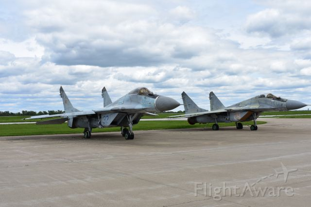 — — - A couple of MiG 29s hanging out on the ramp