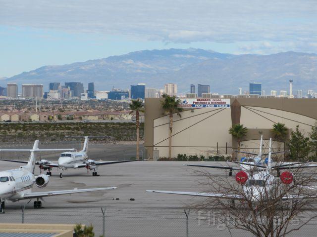 — — - The Henderson Field apron and Las Vegas cityscape