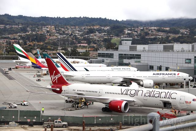 """Boeing 787-9 Dreamliner (G-VOWS) - KSFO - Virgin Atlantic """"WS"""" 787-9 being serviced at the Intl terminal along with a few other Globe-trotters."""