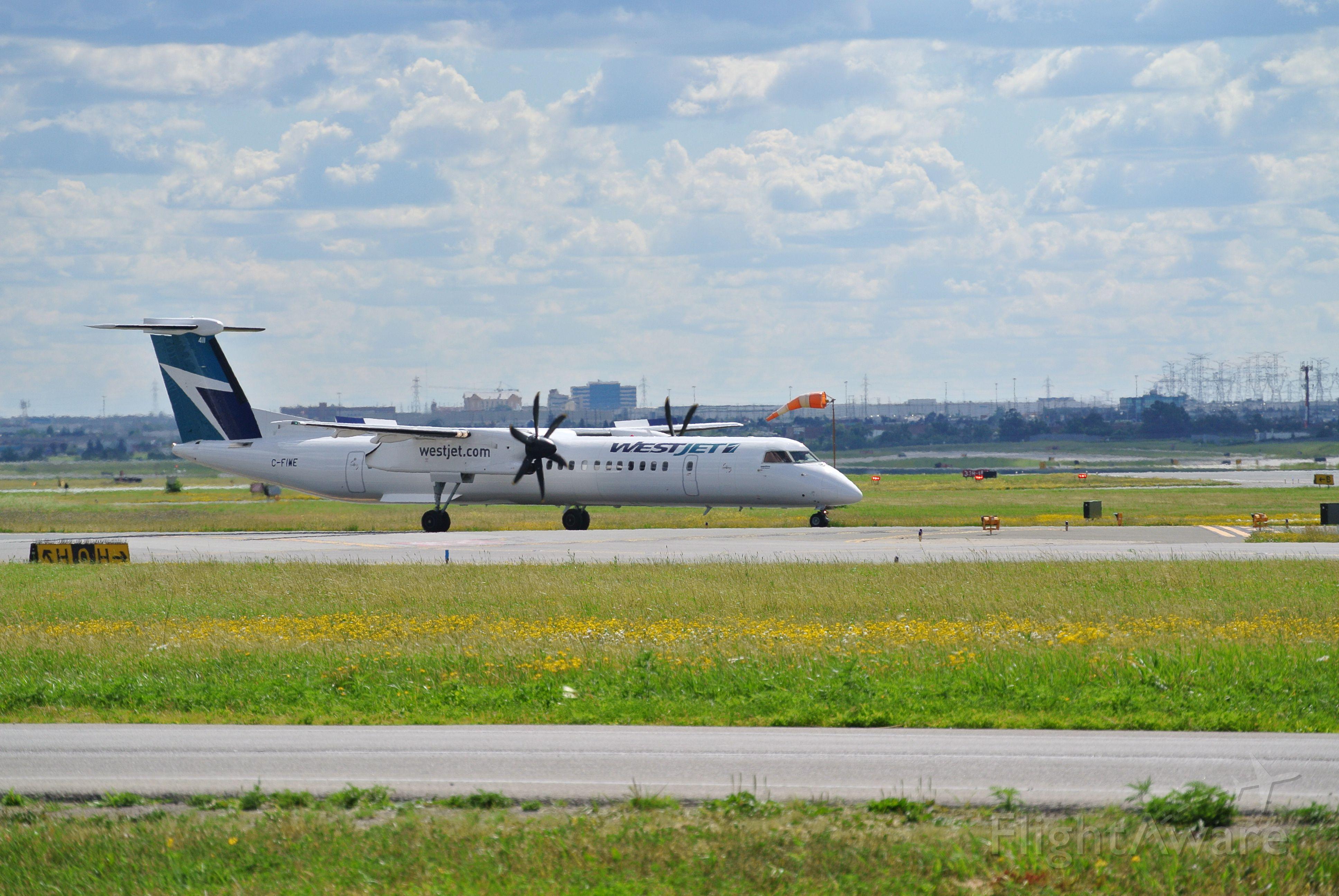 de Havilland Dash 8-400 (C-FIWE) - WestJet encore Dash 8 holding short 23 ready for departure
