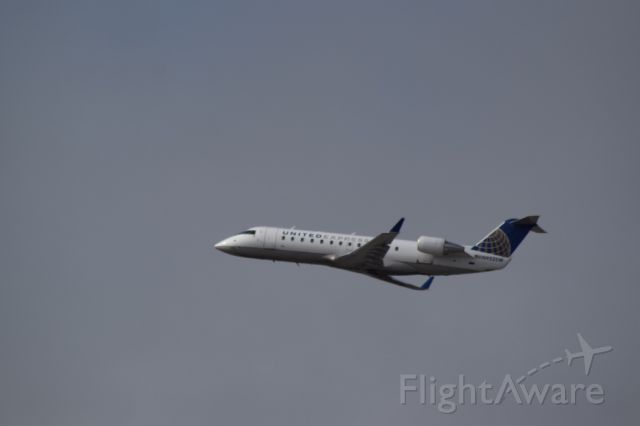 Canadair Regional Jet CRJ-200 (N9525W) - Taking off!