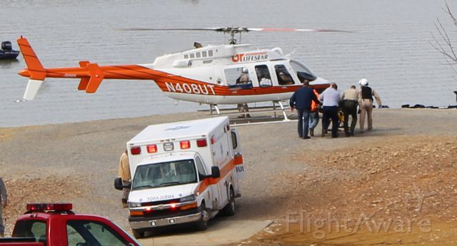Bell 407 (N408UT) - A firefighter told me a construction worker fell off a roof in a very rural area of Sevier County, TN. I live near the end of the road and the only place the pilot could land was this boat ramp. Glad the lake was down for the winter season.