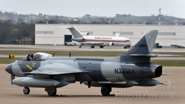 Hawker Hunter (N335AX) - Hawker Hunter Mk. 58, ex Swiss Air Force J-4091, now operated by ATAC, rolling out at Alliance.<br />Bonus Kalitta Charters Boeing 727 in the background.
