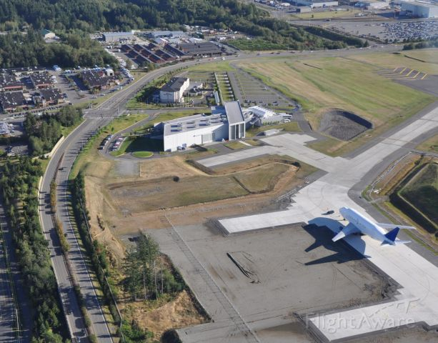 PAE — - 9-4-2010 Aerial photo of the Future of Flight Aviation Center and Boeing Tour facility in Mukilteo, Washington.        A Dreamlifter is parked on the taxiway near what will ultimately be hangars located in the back of the Flight Center (construction was completed in December 2005).  The road immediately to the LEFT of the Center is Paine Field Blvd.  At the stoplight and entrance to the Center (and the Hilton Garden Inn), the road becomes the Boeing Freeway.   The center is on the very EDGE of Paine field (not shown -- but to the right) which is located in Everett, Washington.         Great aerial photo taken by David Parker Brown 9-4-2010.  The photo appears in www.airlinereporter.com downloaded by Bruce McKinnon via a Google search