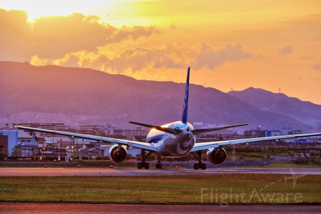 Boeing 777-200 (JA742A) - Sunset pic with ANA B772 in SENRIGAWA point of Osaka,JAPAN.