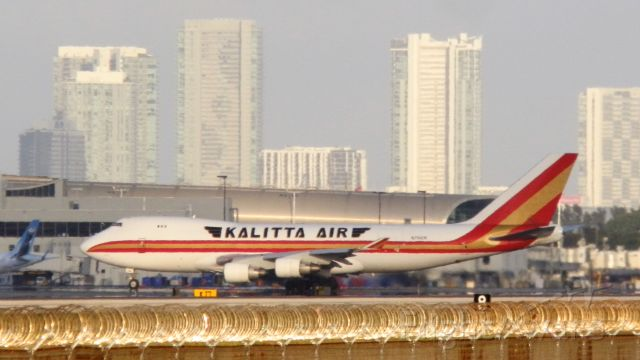 """Boeing 747-400 (N706CK) - With The City of Miami Skyline,and the glistening of concertina wire""""In the sun!"""""""
