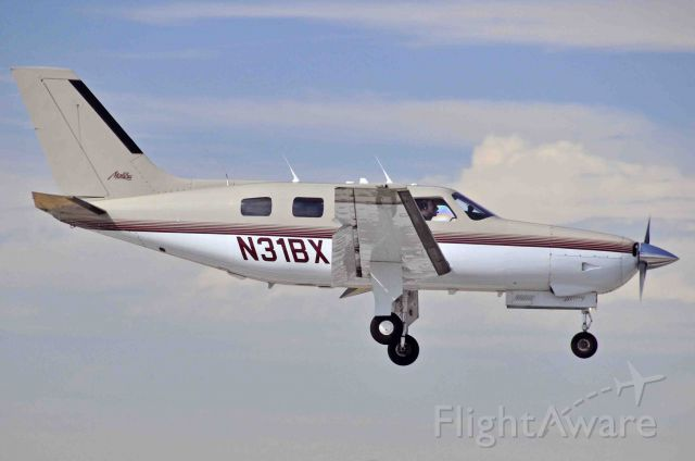 Piper Malibu Mirage (N31BX) - Angel Flight landing at Merced Regional Airport (KMCE)