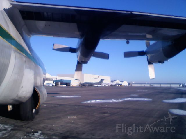 Lockheed C-130 Hercules (N401LC) - Under the wing of a C-130