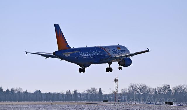 Airbus A320 (N218NV) - Make-A-Wish landing on runway 18 in Fargo, ND (2/19/15)