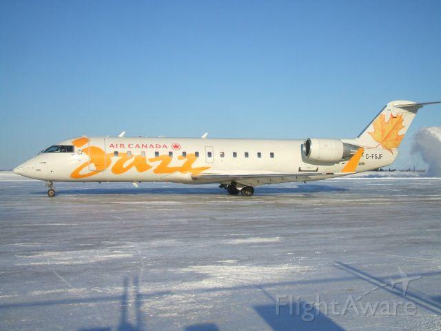 Canadair Regional Jet CRJ-200 (C-FSJF) - Departing the ramp at Goose Airport NL. Jan 18 /09