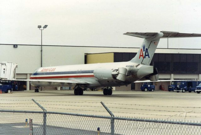 McDonnell Douglas MD-82 (N501AA) - American MD-80 using reverse thrust to back away from the gate at Little Rock.