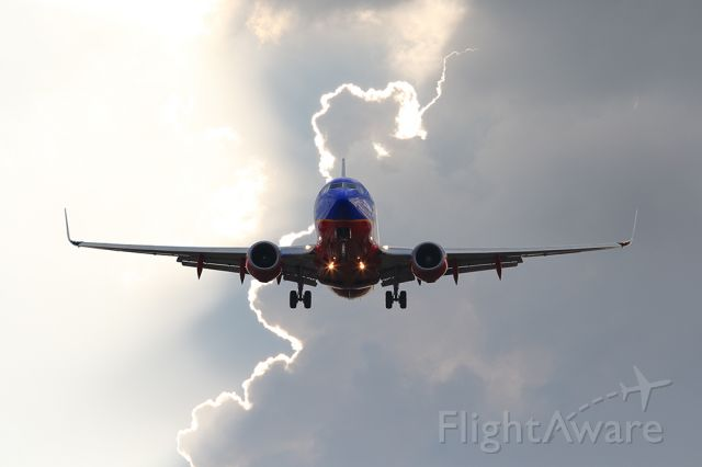 Boeing 737-700 — - An approaching storm created a cool background.