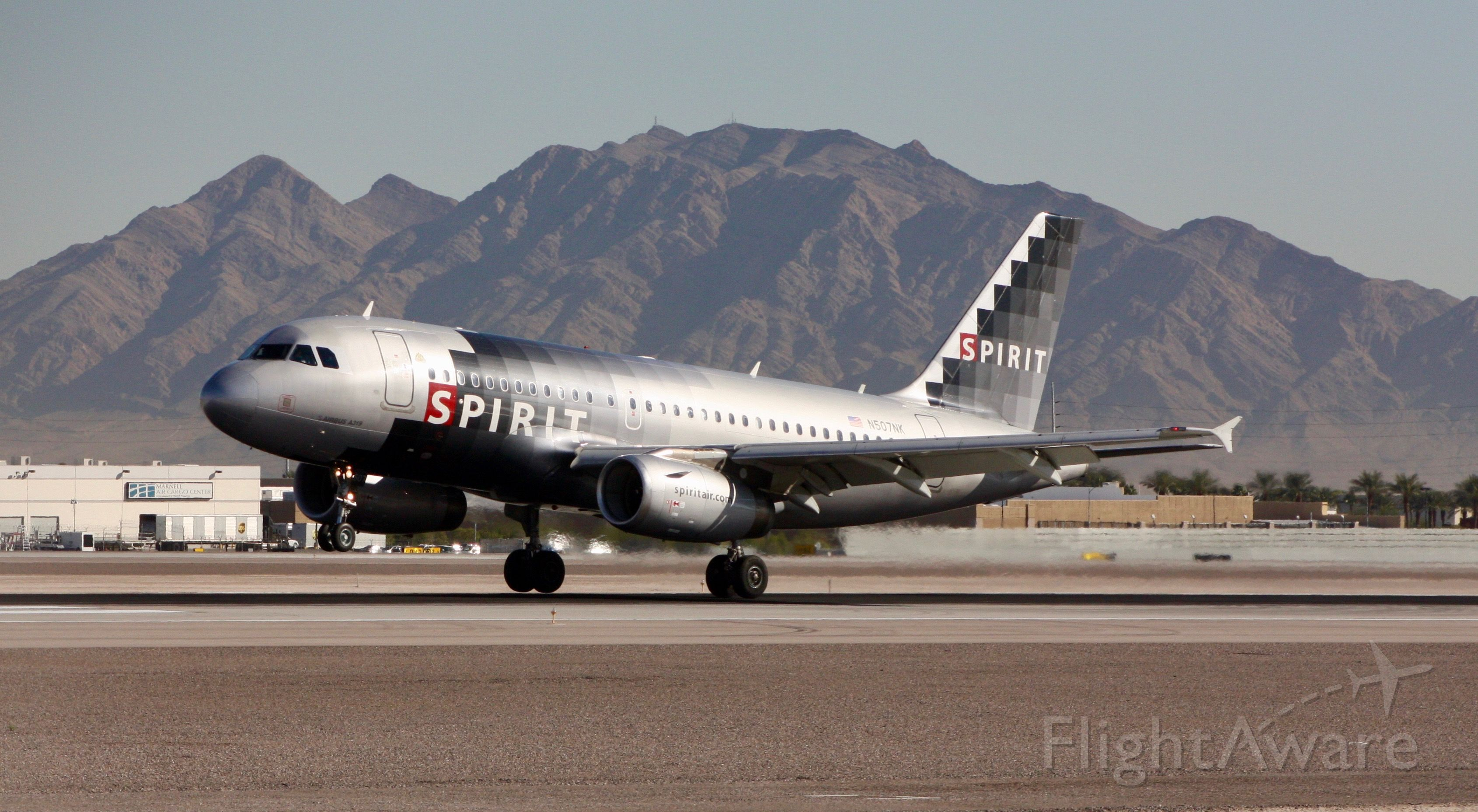 Airbus A319 (N507NK) - Touching down on 26L