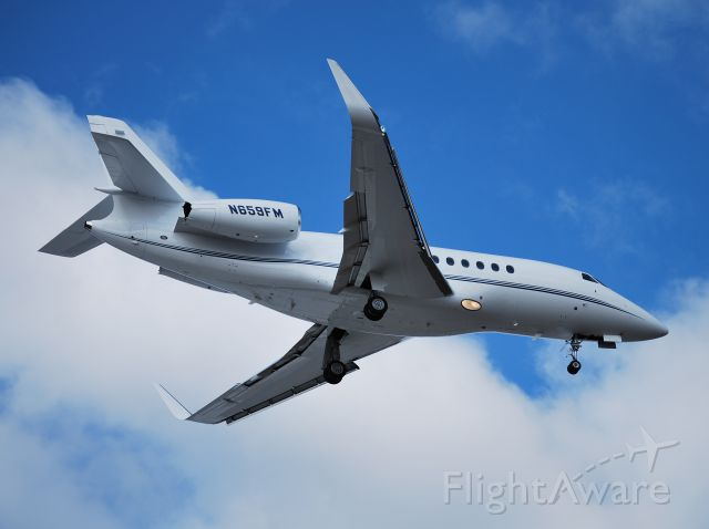 Dassault Falcon 2000 (N659FM) - THAYER ACQUISITIONS LLC on final for runway 2 at KJQF - 3/6/13