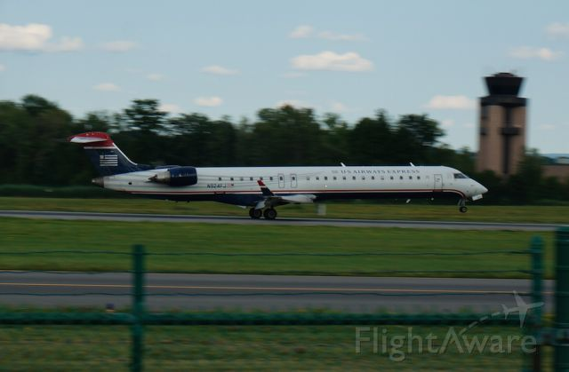 Canadair Regional Jet CRJ-900 (N924FJ) - A CRJ-900 operated by Mesa Airlines kisses runway 19 as it arrives from Charlotte, North Carolina.