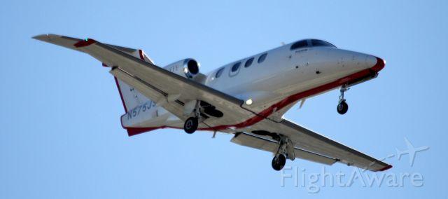 Embraer Phenom 100 (N575JS) - Arrival landing 30L,  10-25-2015
