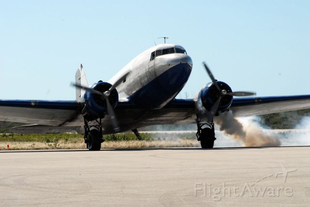 Douglas DC-3 (N86553) - The crew of this old gooney bird is having a horrible time getting the port R-1820 fired up, took almost 10 minutes from first crank to running smoothly