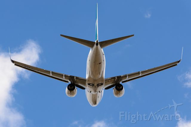 Boeing 737-700 (C-FJWS) - Standing at the opposite end of runway 29 in Calgary.