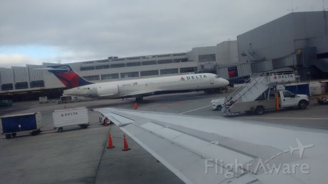 Boeing 717-200 (N975AT) - Seen at gate 40 of the C concourse at SFO. This plane was serving as a delta shuttle with service to LAX. Picture taken from MD-90