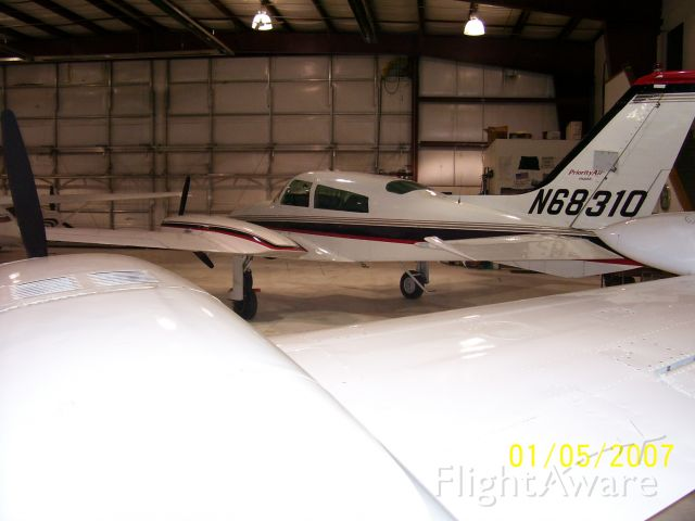 Cessna 310 (N68310) - At home in Watertown, South Dakota. Looking over the wing of 4025C, another 310R based at ATY