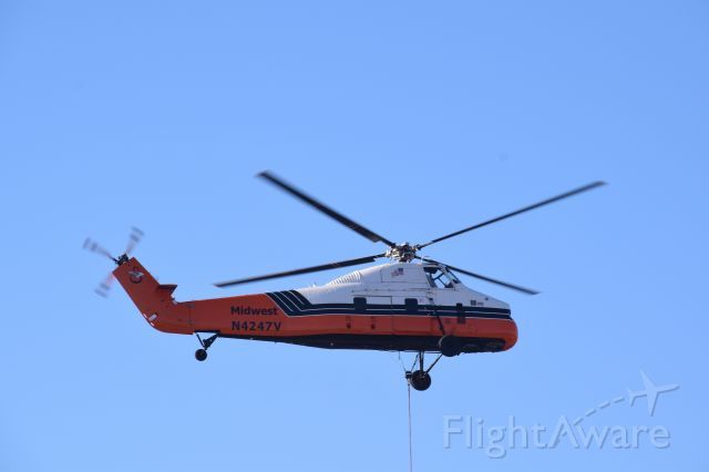 N4247V — - S58 performing heavy lift operations over new Amazon warehouse in Clay NY