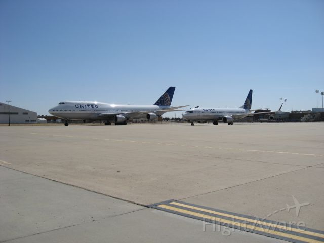 — — - Two freshly-painted aircraft parked at KAMA on Sunday Mar 20, 2011.