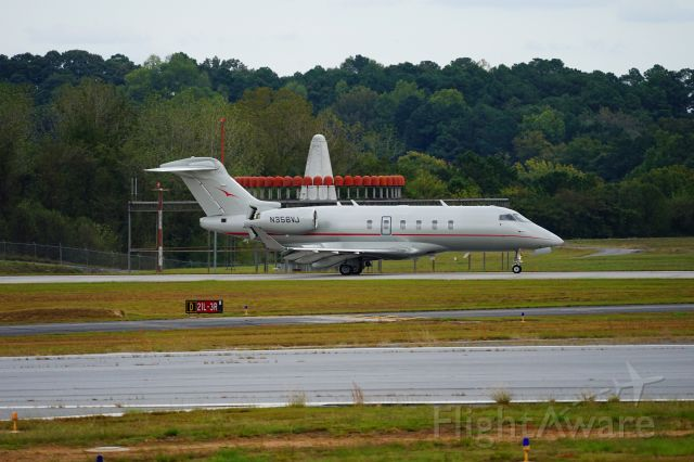 Canadair Challenger 350 (N356VJ) - An elevated viewing platform at Peachtree Dekalb Airport.  It offer a clear view of the runway.  It was landing on Runway 21L, which is the furthest away from the viewing stand.