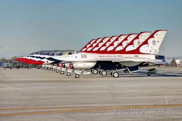 Lockheed F-16 Fighting Falcon — - The U.S. Thunderbirds aircraft are lined up on the ramp for the Gathering of Mustangs and Legends airshow.