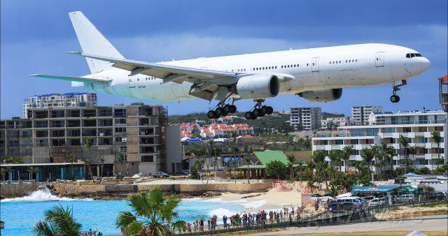 Boeing 777-200 (N777UK) - Private B777UK over the thresh hold maho beach St Maarten for landing.