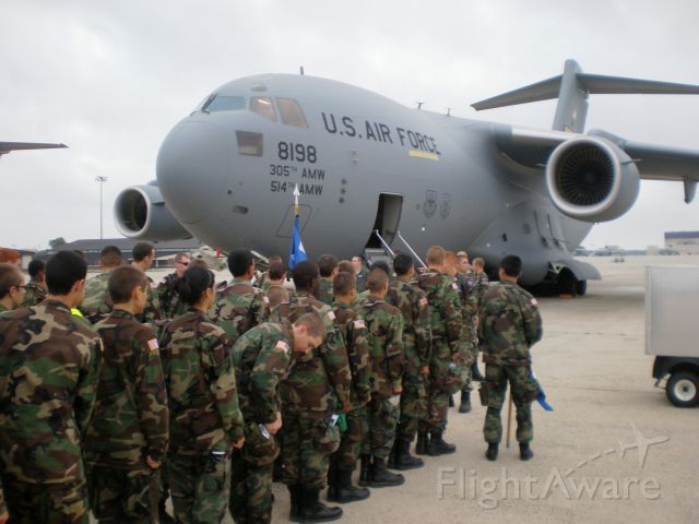 """Boeing Globemaster III — - They sure are sending them off very young! USAF Aux. (Civil Air Patrol) Cadets boarding a C17 at McGuire during Basic Encampment - 6 AS """"Bully Beef Express"""""""