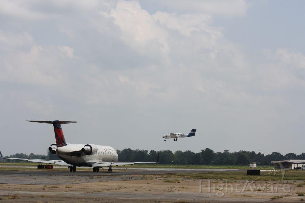 Canadair Regional Jet CRJ-200 (N970EV) - N970EV holding short of RWY 4 at KMLU.
